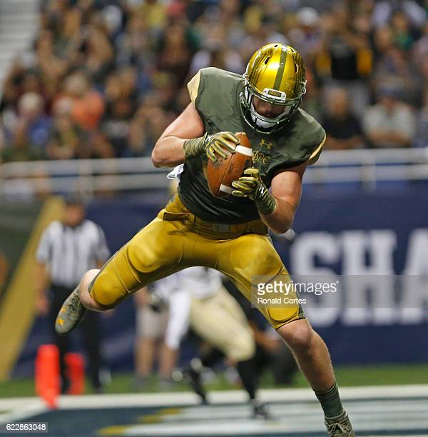 Durham Smythe of the Notre Dame Fighting Irish catches a touchdown reception against Army during the first half of an NCAA college football game at...