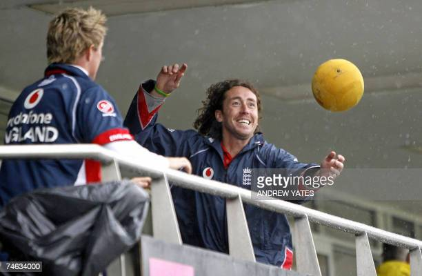 Durham, UNITED KINGDOM: England cricketer Ryan Sidebottom watches his football fly over the players balcony as he and teammates played football while...