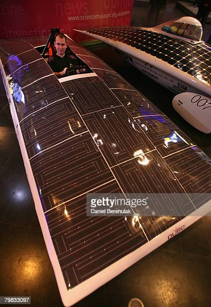 Durham University race team manager Richard Flint poses for photographs in his 2009 World Solar Challenge vehicle during a photo call for the...