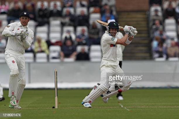 Durham wicket keeper Phil Mustard looks on as Yorkshire's Andy Hodd drives the ball square of the wicket during the County Championship match between...