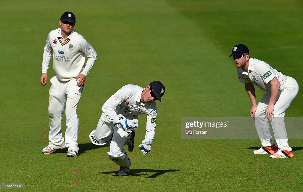 Durham wicketkeeper Michael Richardson fails to stop a boundary as Scott Borthwick (l) and Paul Collingwood look on during day one of the LV County Championship Division One match between Durham and Yorkshire at Emirates Durham ICG on June 28, 2015 in Chester-le-Street, England.