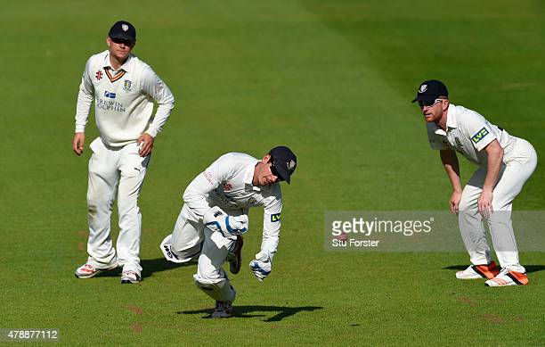 Durham wicketkeeper Michael Richardson fails to stop a boundary as Scott Borthwick and Paul Collingwood look on during day one of the LV County...