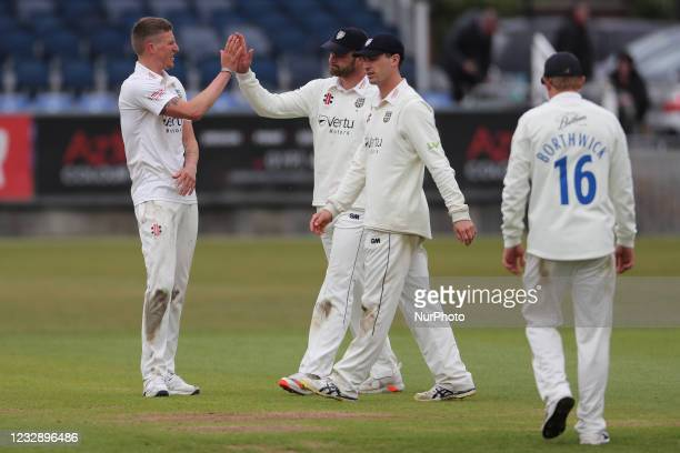 Durham's Brydon Carse celebrates after bowling Worcesterhire's Josh Tongue during the LV= County Championship match between Durham County Cricket...