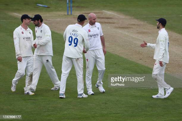 Durham's Chris Rushworth is congratulated by his team mates after taking his 527th first class wicket brining him level with Graham Onions as...