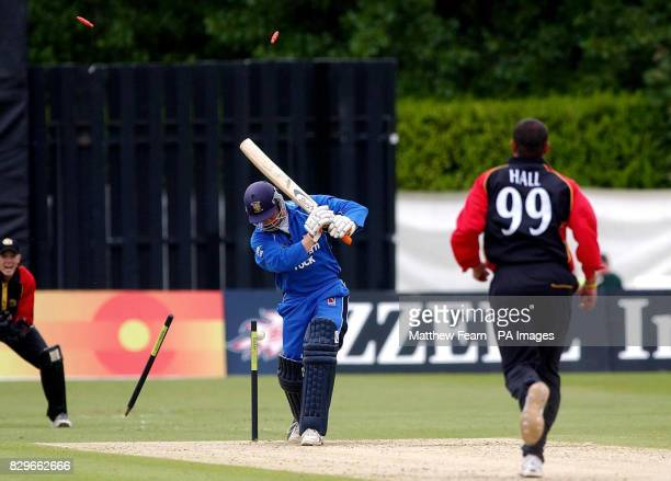 Durham's Jon Lewis is clean bowled by Kent's Andrew Hall for 16 runs as Kent's Niall O'Brien looks on