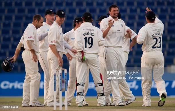 Durham's Steve Harmison celebrates dismissing MCC's David Sales during the LV County Championship match at Sheikh Zayed Stadium Abu Dhabi