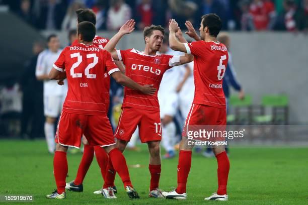 DuRi Cha Andreas Lambertz and Jens Langeneke of Duesseldorf celebrate after the Bundesliga match between Fortuna Duesseldorf and FC Schalke 04 at...