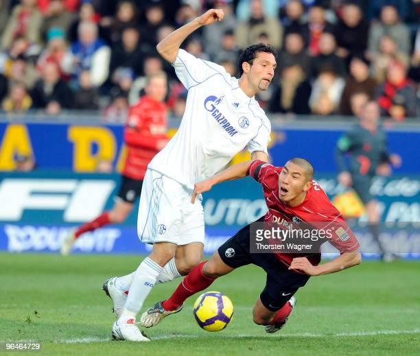 DuRi Cha of Freiburg battles for the ball with Kevin Kuranyi of Schalke during the Bundesliga match between SC Freiburg and FC Schalke 04 at Badenova...