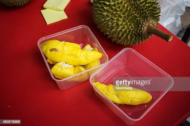Durian fruit sits on a table at a road side stall in Petaling Jaya Selangor Malaysia on Monday July 13 2015 The Southeast Asian native fruit known...