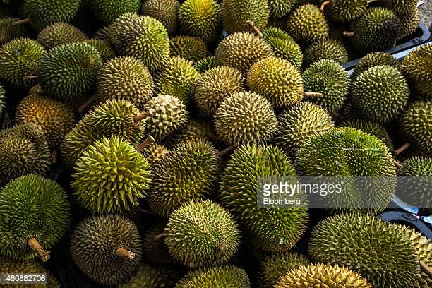 Durians sit stacked at a trader's road side stall in Titi Negeri Sembilan Malaysia on Monday July 13th 2015 in Johor Malaysia The Southeast Asian...