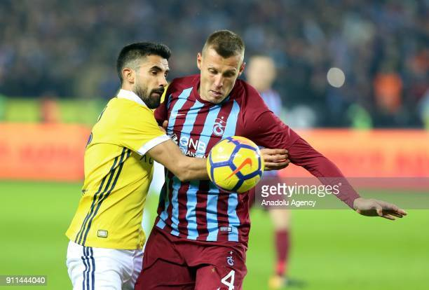 Durica of Trabzonspor in action against Alper Potuk of Fenerbahce during a Turkish Super Lig match between Trabzonspor and Fenerbahce at Medical Park...