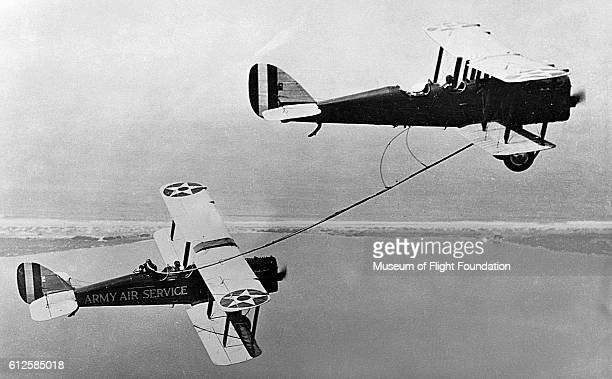 During a 1923 Endurance Record Flight Lt Lowell H Smith and Lt JP Richter attempt the first aerial refueling using the hose transfer method The only...