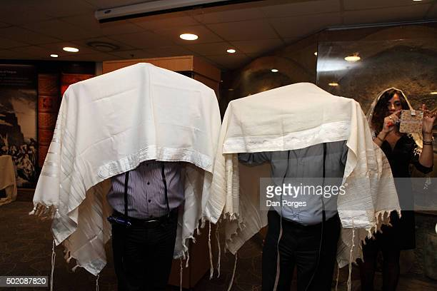 During a Bar Mitzvah ceremony a pair of men hold Tallit over their heads xxx They do this as a rabbi reads a Birkat Kohanim Jerusalem Israel November...
