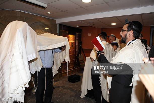 During a Bar Mitzvah ceremony a rabbi reads a Birkat Kohanim to a pair of men under Tallit Jerusalem Israel November 5 2015 The rabbi additionally...