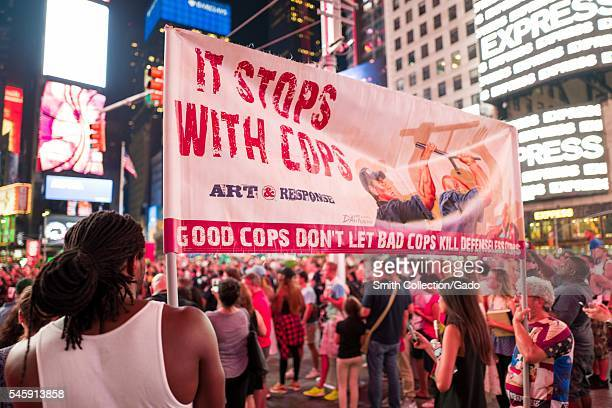 During a Black Lives Matter protest in New York City's Times Square following the shooting deaths of Alton Sterling and Philando Castile a young...
