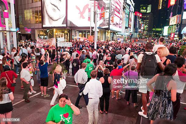 During a Black Lives Matter protest in New York City's Times Square following the shooting deaths of Alton Sterling and Philando Castile activists...