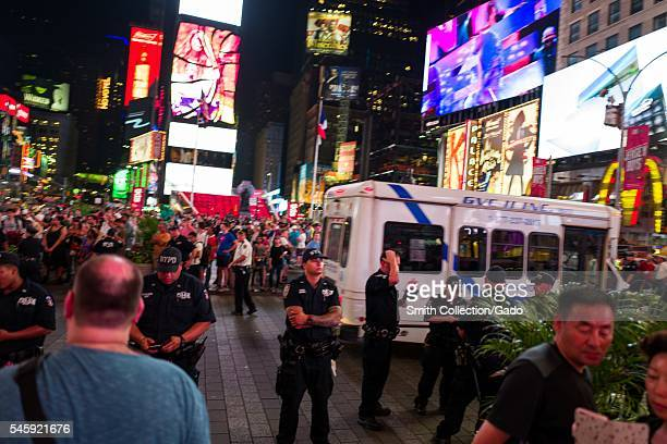 During a Black Lives Matter protest in New York City's Times Square following the shooting deaths of Alton Sterling and Philando Castile, activists...