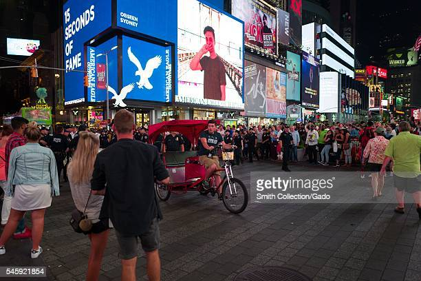 During a Black Lives Matter protest in New York City's Times Square following the shooting deaths of Alton Sterling and Philando Castile a pedal cap...