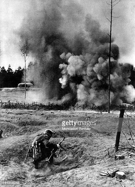 During a bombing on the Maginot Line German miner armed with machine gun advancing in a gun turret fort France May 1940