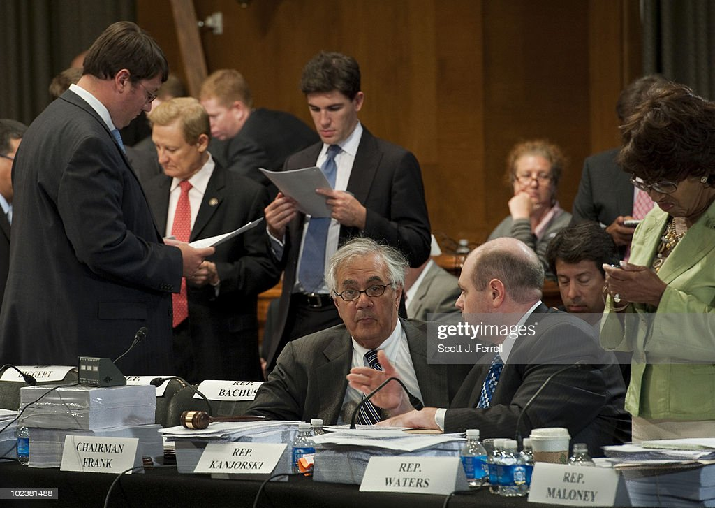 During a break in the House-Senate financial regulatory overhaul conference, House Financial Services ranking member Spencer Bachus, R-Ala., second from left in background, and Chairman Barney Frank, D-Mass., seated at middle, talks to an aide as House and Senate negotiators worked on an agreement on phasing in tougher capital requirements for banks as part of their financial regulatory overhaul legislation. At far right is Rep. Maxine Waters, D-Calif.