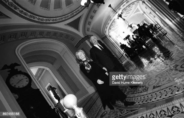 During a break in the Senate Impeachment Trial of President Bill Clinton Sen Pat Leahy accompanied by his wife Marcelle Pomerleau speaks with...