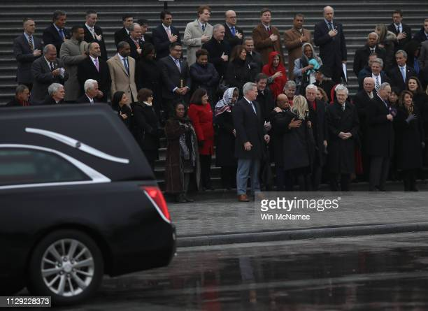 During a brief stop at the U.S. Capitol of the hearse carrying the casket of the late Rep. John Dingell , Rep. Debbie Dingell hugs Rep. John Lewis...