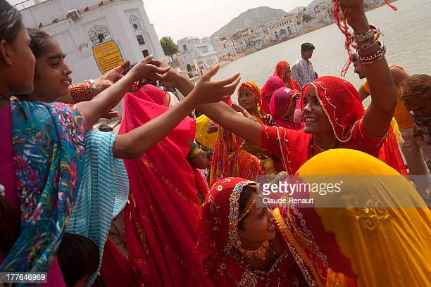 CONTENT] During a ceremonial alongside the sacred lake on the Ghats in Pushkar