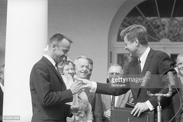 During a ceremony at the White House President Kennedy presents Alan B Shepard Jr with the Distinguished Service Medal for becoming the first...