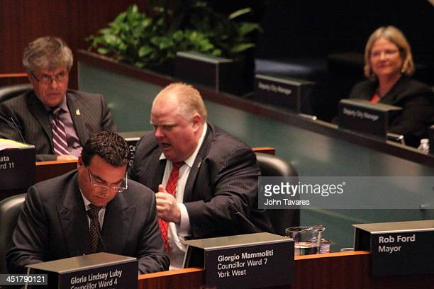 During a city council meeting that drastically reduced his powers as mayor, Mayor Rob Ford uses body language to allude to an incident involving...