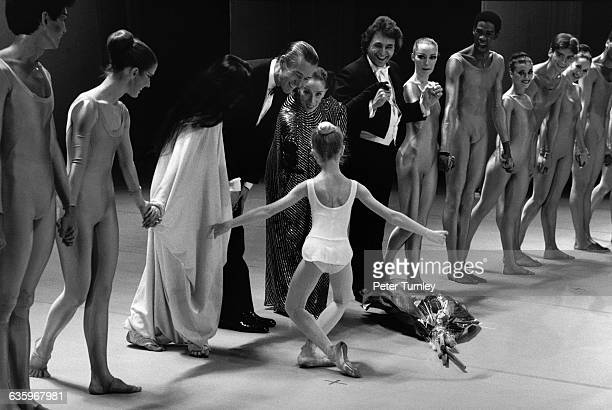 During a curtain call for Martha Graham and her dancers a young ballerina curtsys for Graham and Halston