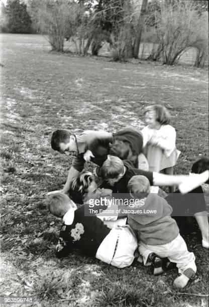 During a football game US Attorney General Robert F Kennedy along with fellow players made up from various Kennedy and neighborhood children tackles...