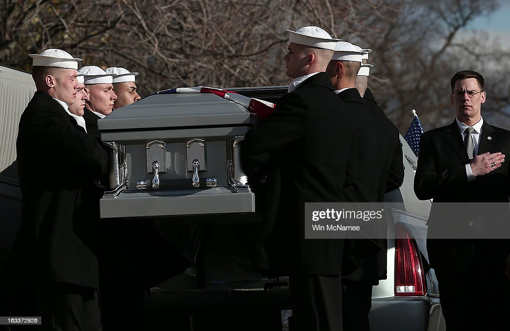 During a funeral service at Arlington National Cemetery, members of a U.S. Navy ceremonial team unload the caskets of two unknown sailors who were killed in 1862 when the Civil War era USS Monitor sank off the coast of North Carolina March 8, 2013 in Arlington, Virgiina. The sailors' remains, recovered when a portion of the ship was raised eleven years ago, were buried with full military honors.
