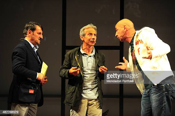 During a gag that deals ironically about contemporary art and its clichés Aldo Baglio stretches toward disconcerted Giovanni Storti under the stern...