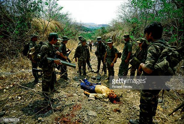 During a governemnt army operation in the countryside a rebel of the MNLF has been killed after a chase and soldiers gathered around his body to try...