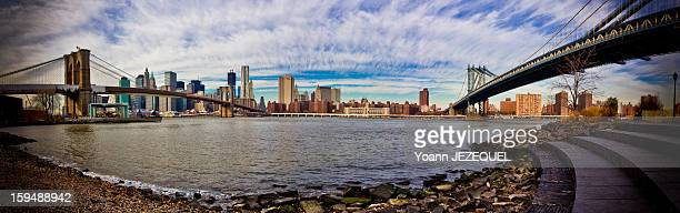 During a holiday s week in New York City , I took this panorama of Manhattan from the Brooklyn bridge Park. It was a great view with the blue sky and...