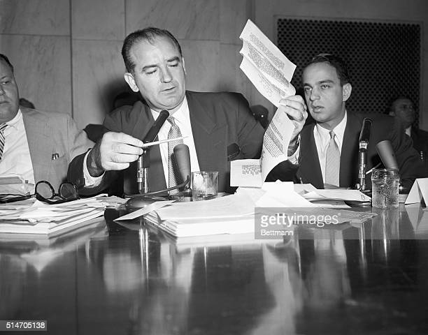 During a House Un-American Activities Committee hearing, Senator Joseph McCarthy holds up a letter purportedly written by FBI Director Hoover in 1941...