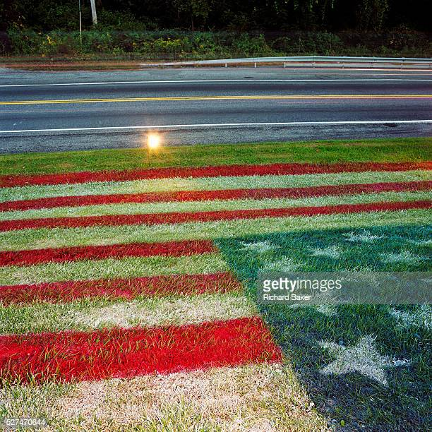 During a journey into America's hinterlands days after the September 11th attacks in New York and Washington DC an American flag has been sprayed...