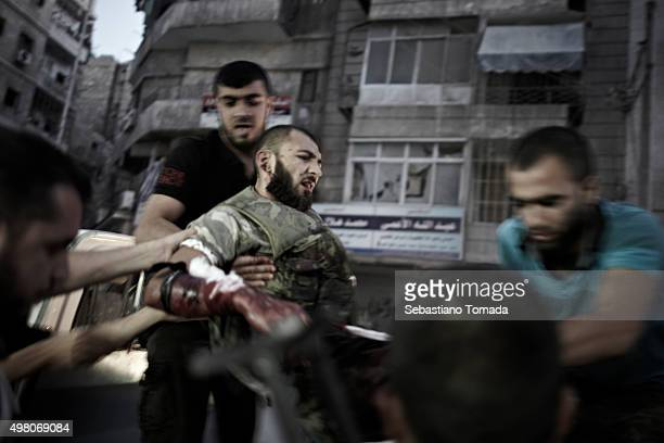 During a kinetic firefight with forces loyal to Bashar Al Assad's regime a wounded member of Free Syrian Army is carried away from one of Aleppo's...