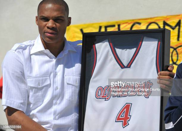Scott Varley During a lunchtime ceremony Leuzinger High School retired the  basketball jersey worn by alumni 759475219