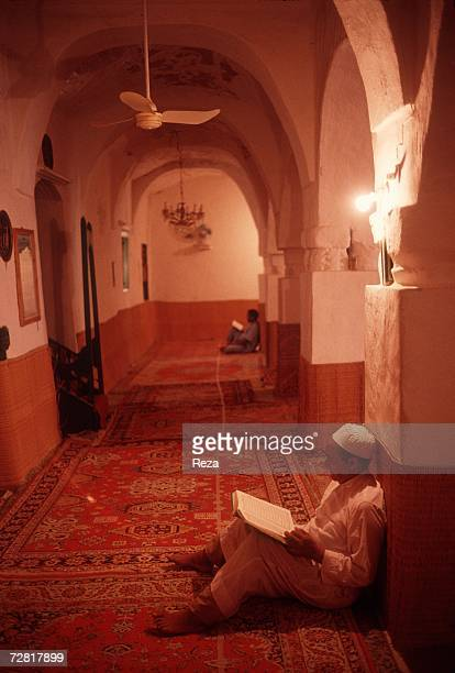 During a mourning men read prayer books April 2000 in Ghadames Libya