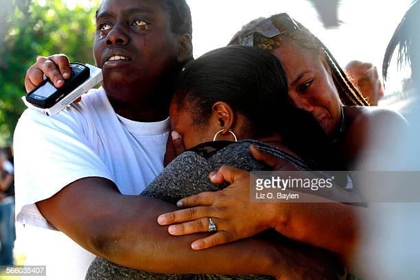 During a neighborhood vigil for Mireya Nila McCall Kaneisha Dunn Laneasha Woods and Tanisha Caliman comfort each other Mireya Laneasha Wood's niece...