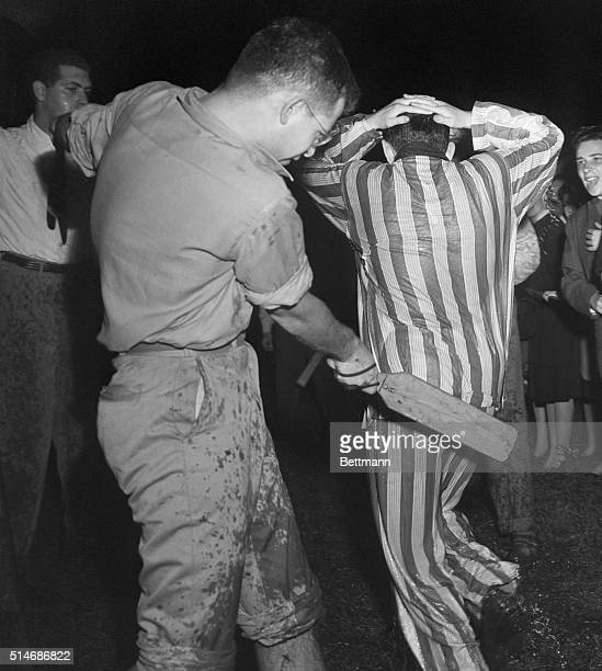 During a New York University hazing ceremony a freshman flees from a paddleweilding senior after being dunked in the Fountain of Knowledge