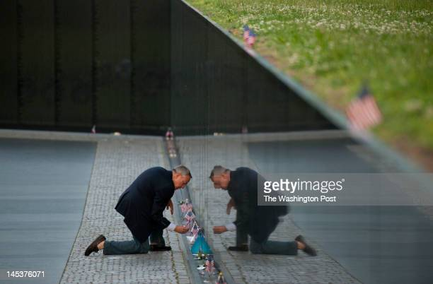 During a portrait session and not prompted by the photographer Jan Scruggs looks at items left at the Vietnam Veterans Memorial on Friday May 04 2012...