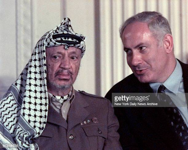 During a press briefing in the East Room of the White House Wednesday Yasser Arafat sat stone faced as Israeli Prime Minister Benjamin Netanyahu...
