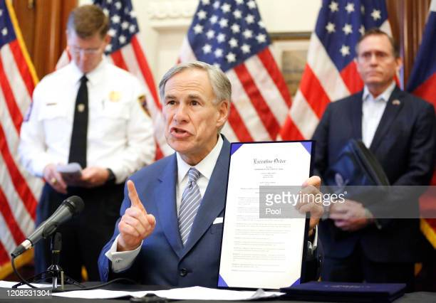 During a press conference at the Texas State Capitol in Austin Texas Governor Greg Abbott holds a new executive order stating that travel from other...