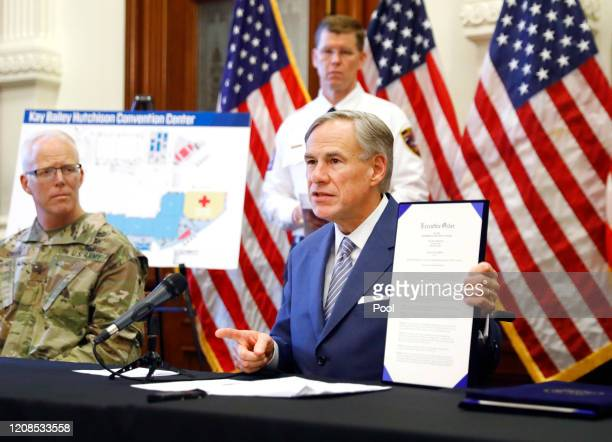 During a press conference at the Texas State Capitol in Austin Texas Governor Greg Abbott holds a new executive order Sunday March 29 2020 He also...