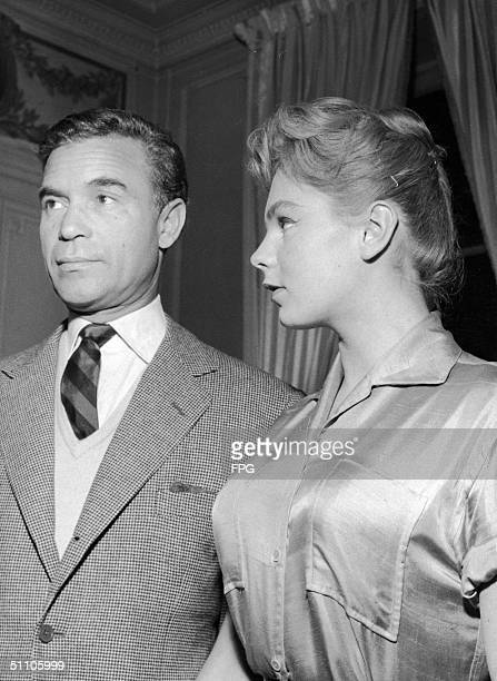 During a press conference Dominican diplomat and socialite Porfirio Rubirosa announces his impending marriage to French actress Odile Rodin Paris...