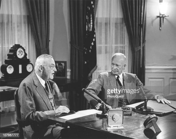 During a radio and television broadcast US Secretary of State White House John Foster Dulles speaks with US President Dwight Eisenhower in the Oval...
