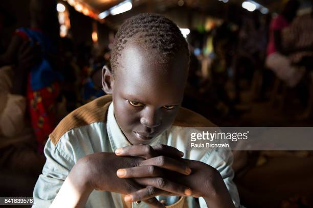 During a religious service at the Seventh Day Adventist church a Sudanese boy listens to a sermon the Sudanese are very religious The Onward Struggle...