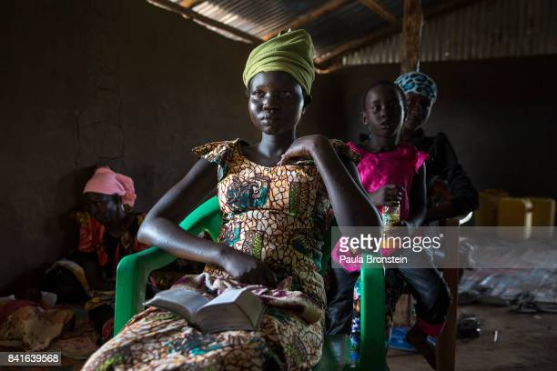 During a religious service at the Seventh Day Adventist church a Sudanese woman listens to a sermon the Sudanese are very religious The Onward...